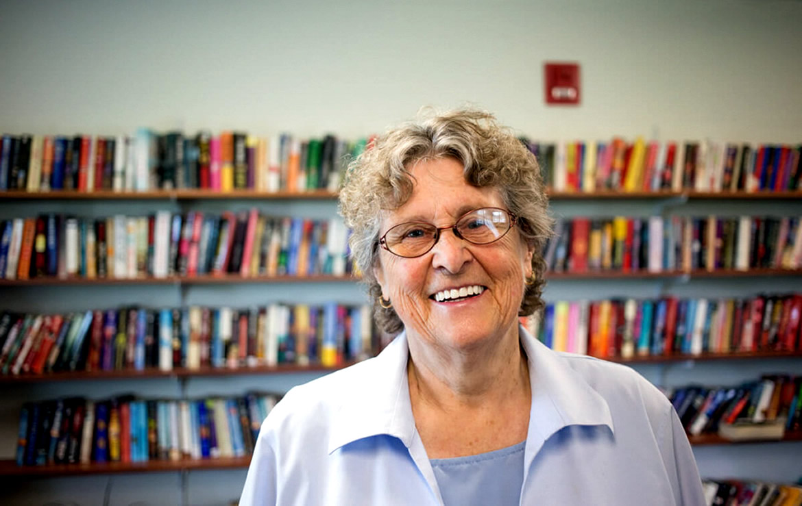 A photo of Ann in the library.