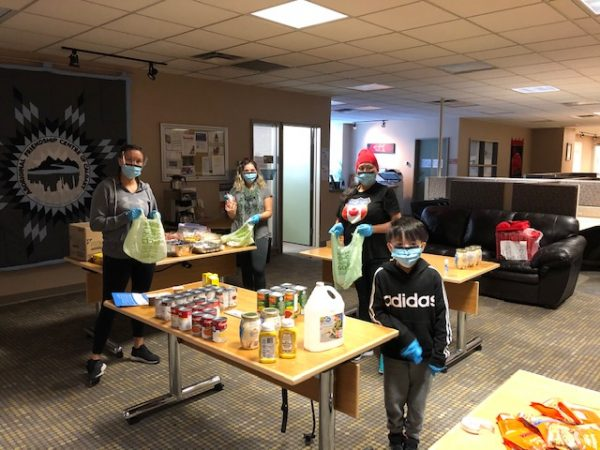 Indigenous community packing food for Covid-19 relief efforts
