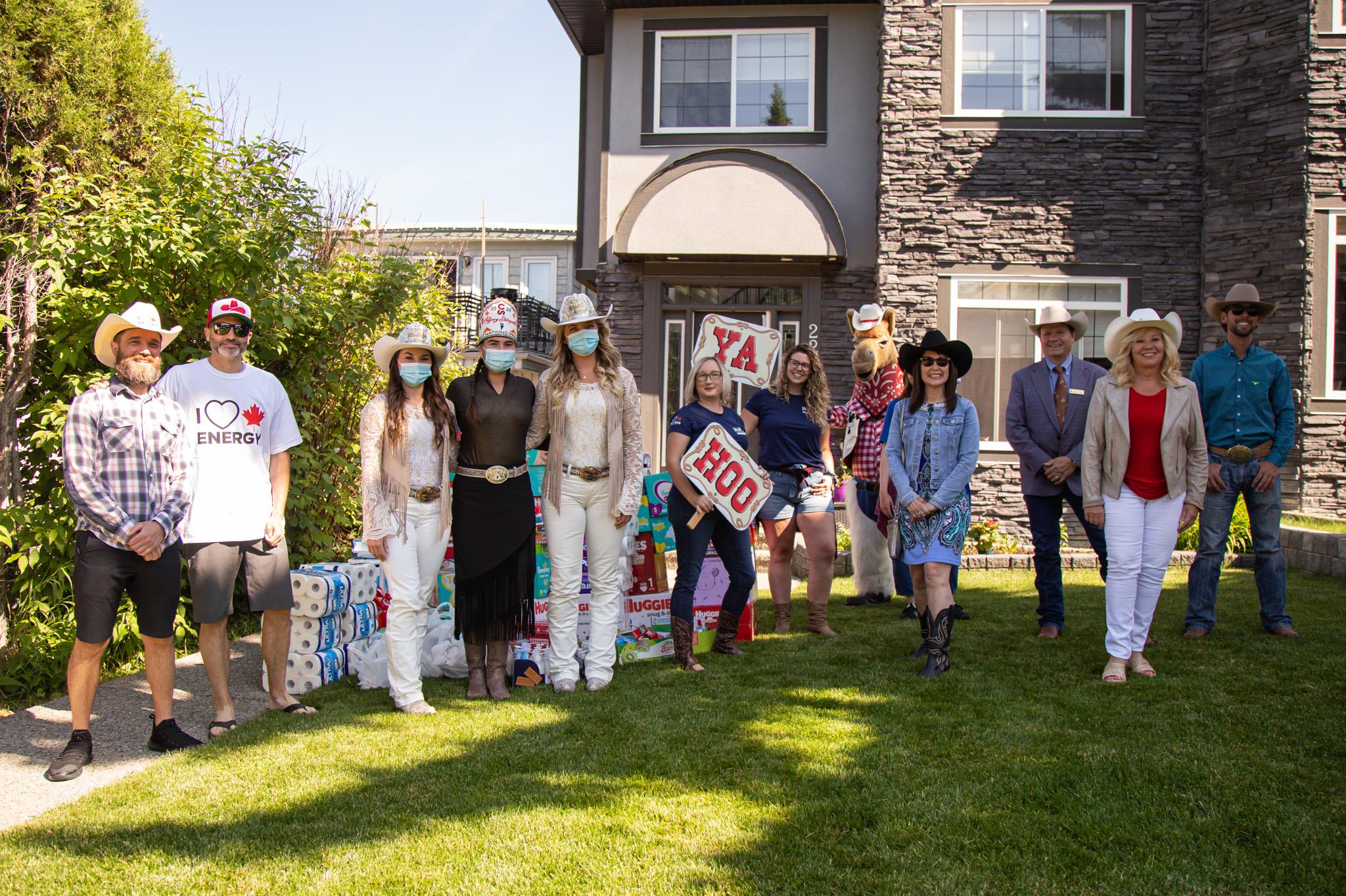 Group shot of individuals with Ya Hoo signs at a donation pick up spot