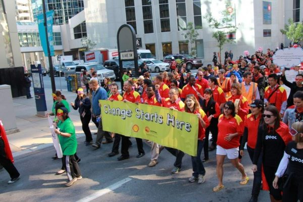 Shell employees walking in a celebration of community.