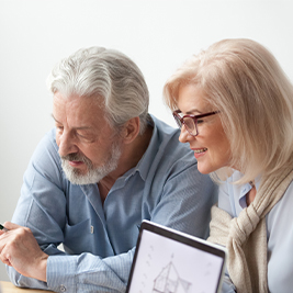 Couple sitting together looking at planned giving options