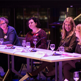 A panel of local female leaders speak at a Women United event.