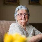 Close-up portrait of happy senior woman