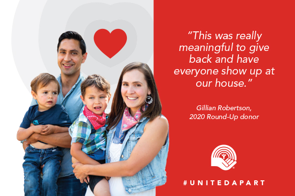 Family standing together at the Basic Needs Round-Up