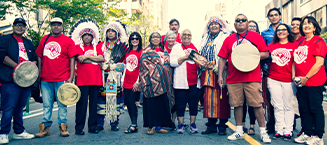 A group of individuals including indigenous elders at a United Way event.